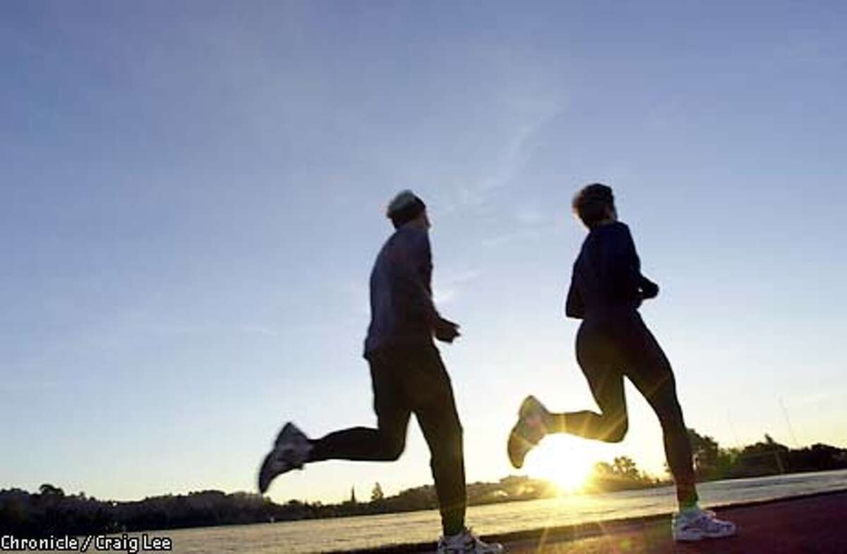 """Shirley Matson didn't take up running until she was in her late 30's-early 40's, and now at age 61, she holds about every middle- to long-distance running record for women in age groups 50 and up. Photo of Shirley Matson (right) running alongside Elmo Shropshire. (side note, Elmo Shropshire happens to be the guy who wrote and played the hit song """"Grandma Got Run Over By A Reindeer"""" a hit cult song classic.) Photo by Craig Lee/San Francisco Chronicle"""