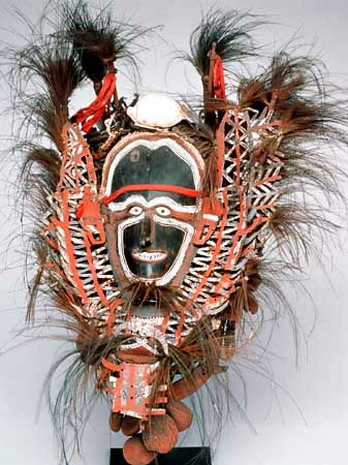 """Mortuary Mask, 19th c. Torres Strait. Shell, feathers, fiber lime, red paste, trade cloth. 25""""x20"""" Gift of Marcia and John Friede. Masterworks of New Guinea Art: Selections from the Marcia and John Friede Collection. Legion of Honor 2 February-5 May 2002. Photo: HANDOUT"""