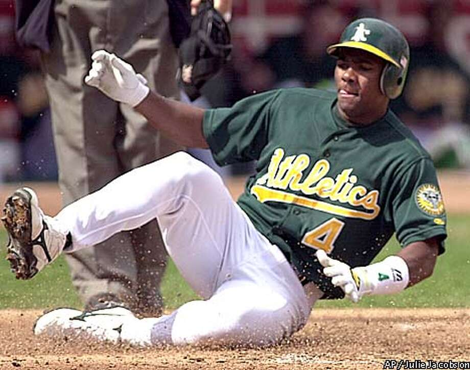 Oakland Athletics shortstop Miguel Tejada steals home safely on a wild pitch thrown by Seattle Mariners right hander Joel Pineiro during the first inning Saturday, Sept. 22, 2001 in Oakland, Calif. (AP Photo/Julie Jacobson) Photo: JULIE JACOBSON