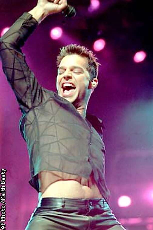 Puerto Rican pop sensation Ricky Martin performs before a crowd of 25,000 during a concert at the SkyDome in Toronto, Canada Saturday, Mar. 18, 2000. (AP Photo / Keith Beaty) Photo: KEITH BEATY