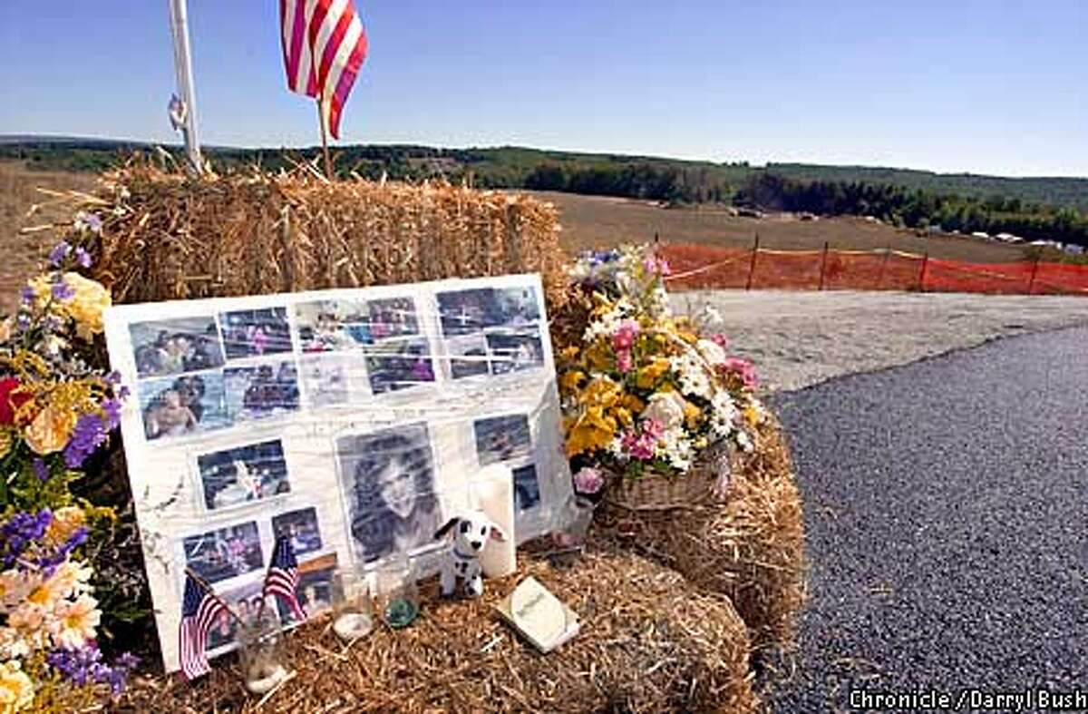 A memorial stands at the hill overlooking the area where United Flight 93 crashed in rural Pennsylvania near Shanksville. The memorial has pictures of Deborah Jacobs-Welsh, one of the victims of Flight 93. Only family and media on police escort, are allowed to this area overlooking the crash site. Chronicle Photo by Darryl Bush