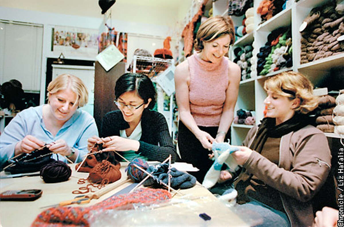 Knitters gather nearly every night of the week for workshops at Atelier Yarns in San Francisco. Chronicle photo by Liz Hafalia