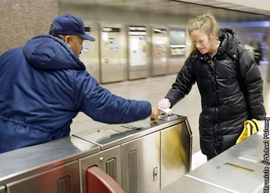 Sabine Wolfson of San Rafael gets assistance from Embarcadero BART Station agent Michael Stewart as she uses her Translink pass for the first time. She was headed to Berkeley.  CHRONICLE PHOTO BY MICHAEL MALONEY Photo: MICHAEL MALONEY