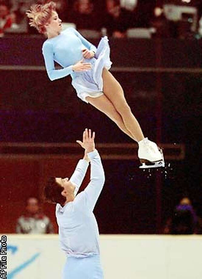 BEREZHNAYA SIKHARULIDZE Anton Sikharulidze lifts his partner Elena Berezhnaya of Russia during the Pairs Short Program at the XVIII Winter Olympics, Sunday, Feb. 8, 1998 in Nagano, Japan. The couple finished third for the evening. (AP Photo/Eric Draper)