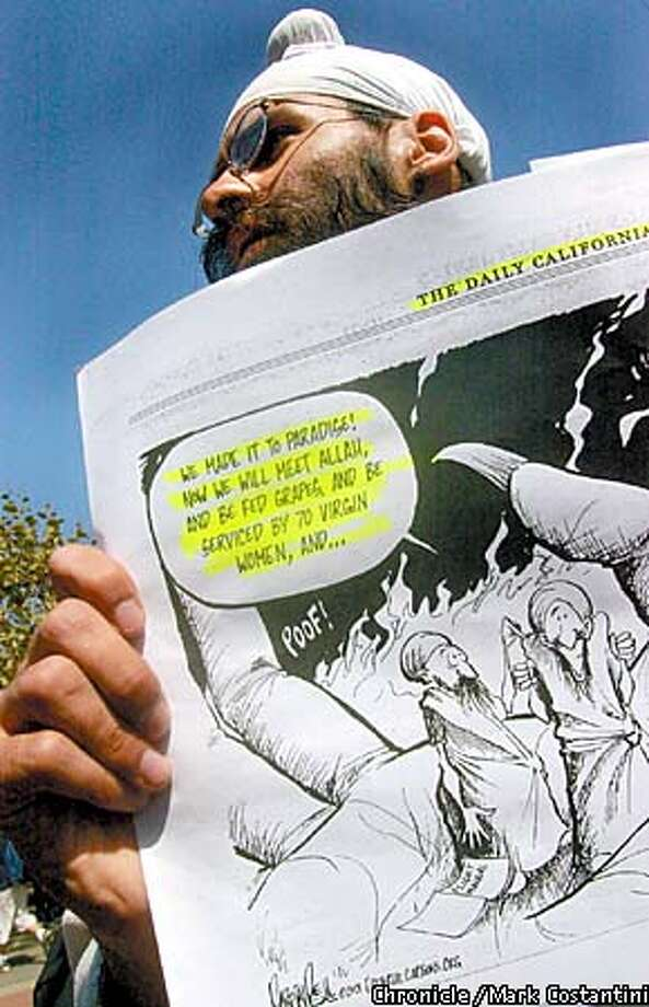 PROTEST AT UC BERKELEY OVER CARTOON THAT RAN IN YESTERDAY'S DAILY CAL. HERE, KAVNEET ALAG, A SIKH AND UC BERKELEY SENIOR HOLDS A COPY OF THE CARTOON. PHOTO: MARK COSTANTINI/THE CHRONICLE Photo: MARK COSTANTINI