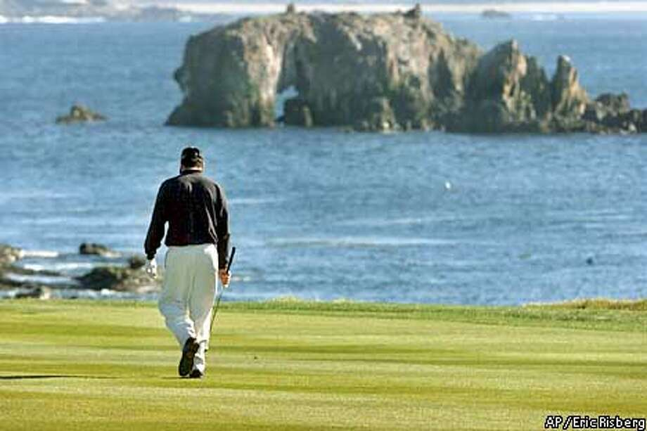 Pat Perez walks back to the 18th tee after hitting his first tee shot out of bounds in the final round of the AT&T National Pro-Am in , Calif., Sunday, Feb . 3, 2002. Perez, who lead the tournament through rounds two and three, lost on the final hole to Matt Gogel after making triple bogey. (AP Photo/Eric Risberg) Photo: ERIC RISBERG