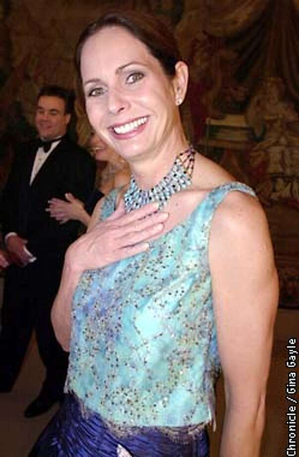 Kathryn Keller an Auxilary member of Marin shows off her turquoise necklace that compliments her Lili Samii (spelling?)beaded camisole and saphire blue floor length skirt at the opening night gala for the San Francisco Ballet at the War Memorial building. Photo by Gina Gayle/The SF Chronicle. Photo: GINA GAYLE