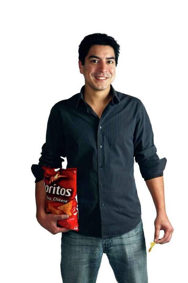 """CONEXION: Eric Delgado, a San Antonio-based actor and writer, wrote the script for one of five finalists in the national Doritos """"Crash the Super Bowl"""" commercial contest. The grand prize winner airs during the Super Bowl, and its creative team wins $1 million.   Helen L. Montoya/San Antonio Express-News Photo: HELEN L. MONTOYA, San Antonio Express-News / ©SAN ANTONIO EXPRESS-NEWS"""