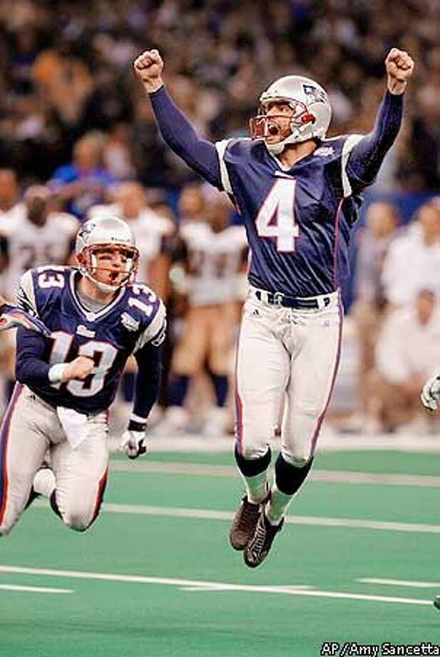 New England Patriots' kicker Adam Vinatieri celebrates his 48-yard game-winning field goal in the final seconds of XXXVI against the St. Louis Rams Sunday, Feb. 3, 2002 in New Orleans. At left is teammate Ken Walters. (AP Photo/Amy Sancetta) Photo: AMY SANCETTA
