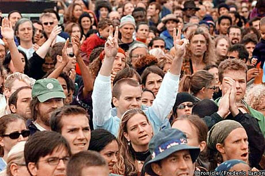 ": Hundreds of people join in a peace concert at Precita Park in SF, put on by the ""Global Exchange"" an organization that condemns the attacks on September 11th but urging people and leaders that vengeance offers no relief. Chronicle photo by Frederic Larson Photo: FREDERIC LARSON"