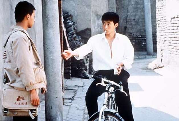 "Cui Lin as Guei (left) and Lee bin as Jian in ""Beijing Bicycle."" Photo: HANDOUT"