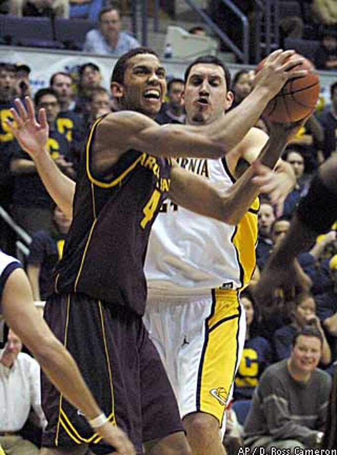 Amit Tamir, guarding Arizona State's Tommy Smith (left), and the Bears held the Sun Devils to 38.7 percent shooting. Associated Press photo by D. Ross Cameron