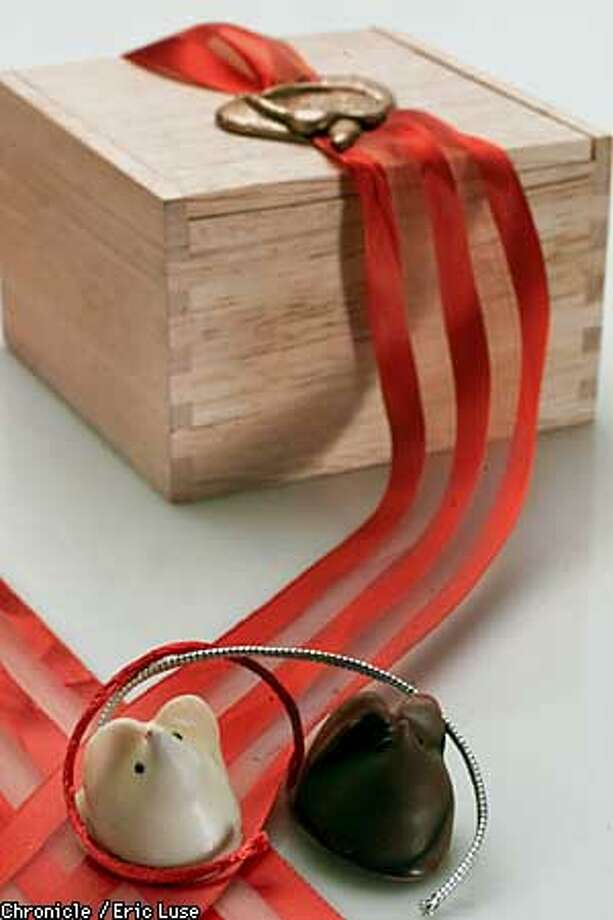 Small wooden box of chocolates which includes two mice complete with tails.  BY ERIC LUSE/THE CHRONICLE Photo: ERIC LUSE