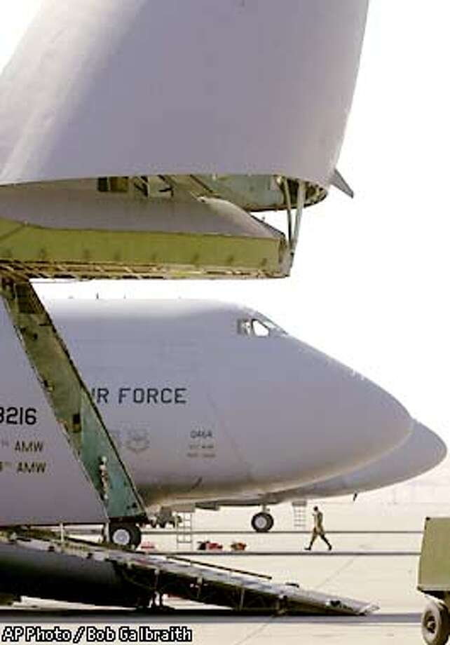 The nose of a U.S. Air Force C-5 airplane is in the upright position and ready for loading at Travis Air Force Base in Fairfield, Calif. Friday, Sept. 14, 2001. The base in on heightened alert following the attacks on the United States. California reserve units are being mobilized as part of President Bush's call-up of up to 50,000 reservists to active duty Friday and Travis has 3,500 reservists according to base spokesman Ron Lake who said it likely will take days for the Pentagon to tell units who is called up and when.(AP Photo/Bob Galbraith) Photo: BOB GALBRAITH
