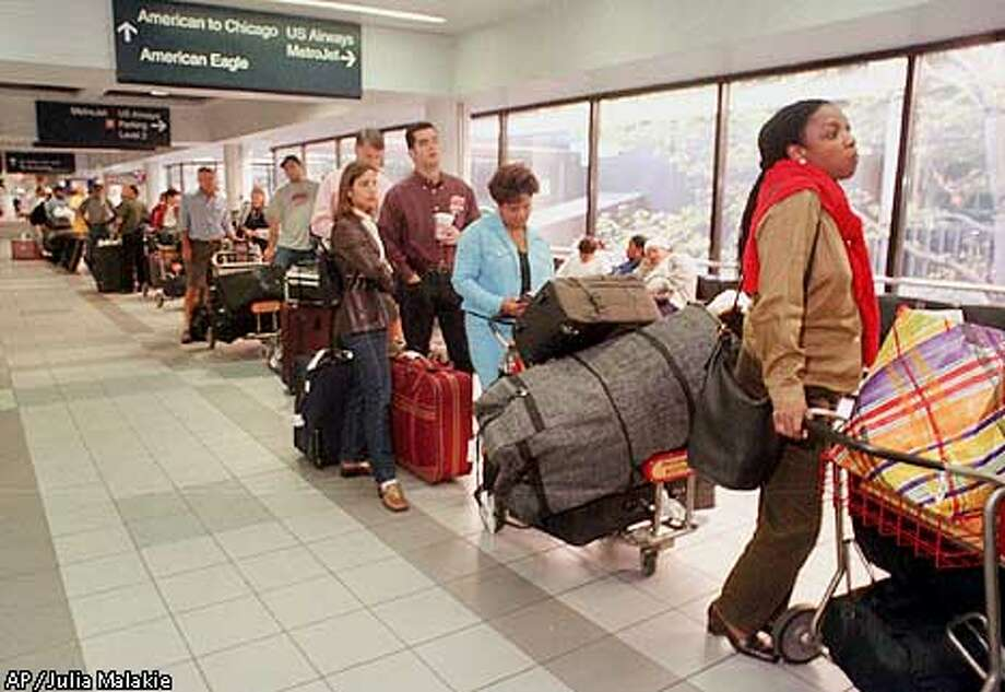 A long line of American Airlines passengers wait Monday morning, Sept. 17, 2001 at Boston's Logan International Airport, to check in with their baggage for flights around the country. (AP Photo/Julia Malakie) Photo: JULIA MALAKIE