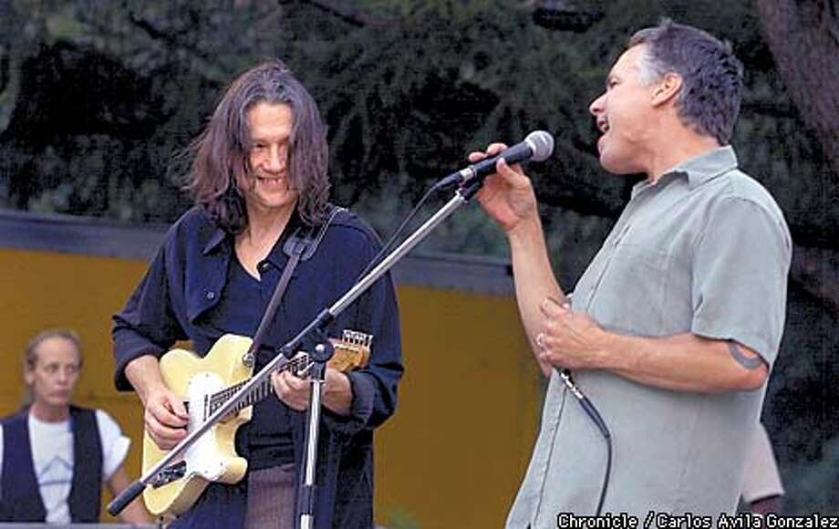 "Musician, Robben Ford, smiles at his brother, Mark during the Ukiah, ""Sundays in the Park,"" concert which included his brother, Patrick, on Sunday, August 26, 2001. Robben and his brothers will be performing at the S F Blues Festival in September. (Photo by Carlos Avila Gonzalez/The San Francisco Chronicle) Photo: CARLOS AVILA GONZALEZ"