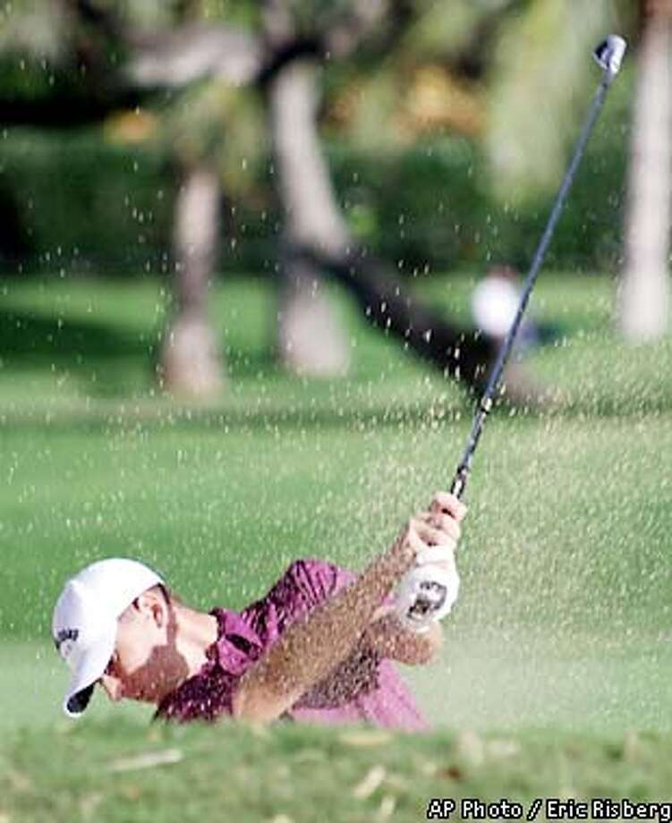 Rookie Charles Howell III hits out of a bunker on the 13th fairway of the Waialae Country Club during first round play of the in Honolulu, Thursday Jan. 10, 2002.(AP Photo/Eric Risberg) Photo: ERIC RISBERG