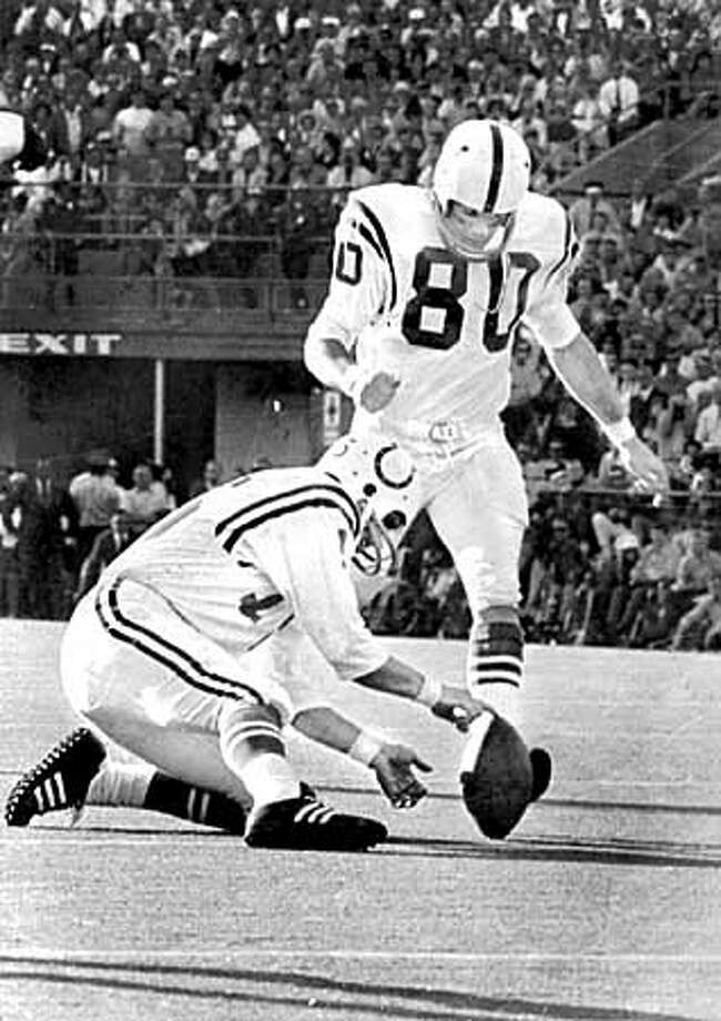 MIAMI, FLA--1971-- Jim O'Brien of the Baltimore Colts kicks a field goal from 32 yards out. Photo by UPI/file photo (scanned 02/04/02) Photo: UPI