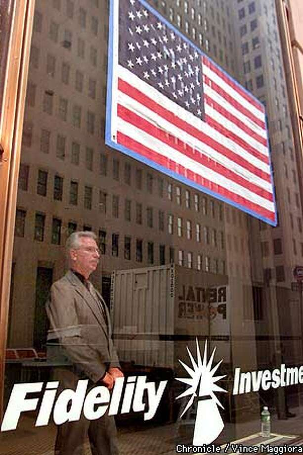 William Sharp with Fidelity Investment looking out his window. Business tries to resume around Wall st. Days after the terrorist attack on the World Trade Center in New York  BY Vince Maggiora Photo: VINCE MAGGIORA