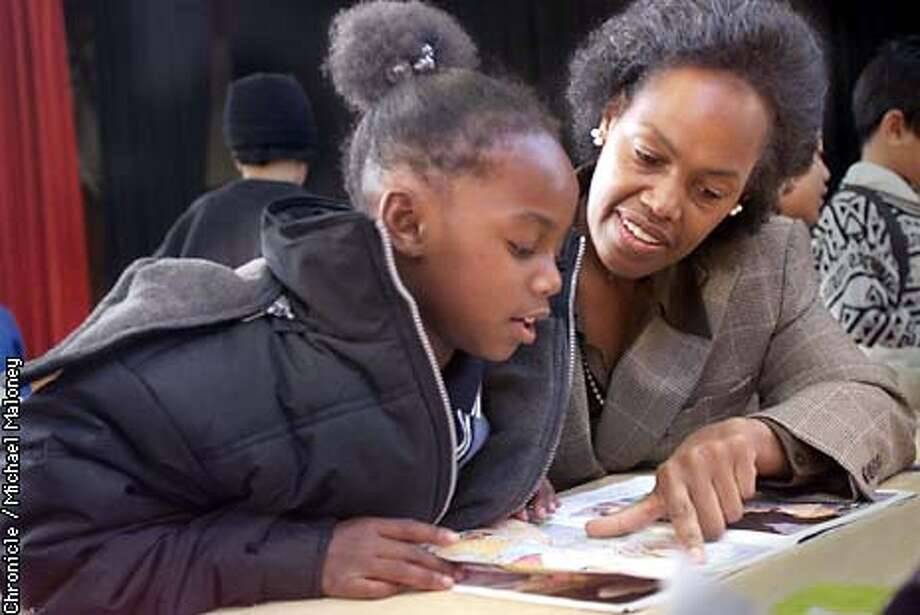"""Sophie Maxwell, new member of the SF Board of Supervisors visited Starr King Elementary School to read to the students during a """"Books for Breakfast"""" reading program. She reads with 1st grader Shauneke Roberson (both cq)  CHRONICLE PHOTO BY MICHAEL MALONEY Photo: MICHAEL MALONEY"""