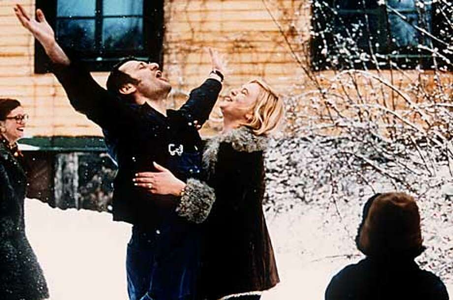 ROLF (MICHAEL NYQVIST) REJOICING WITH WIFE ELIZABETH (LISA LINDGREN) IN A SCENE FROM TOGETHER, WRITTEN AND DIRECTED BY LUKAS MOODYSSON Photo: HANDOUT