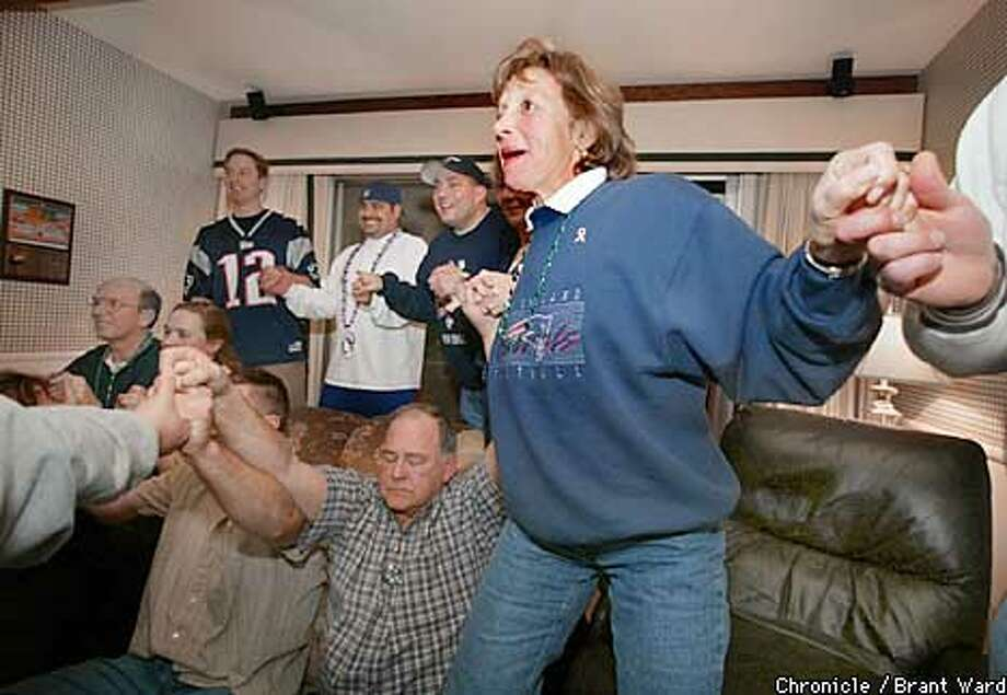 Patriot kicker Adam Vinatieri's aunt Barbara Albright, right, held hands with members of Tom Brady's family and friends inside the Brady home in San Mateo the moment her nephew kicked the Super Bowl winning field goal...By Brant Ward/Chronicle Photo: BRANT WARD