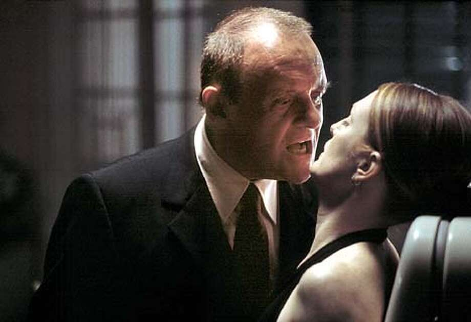 "Anthony Hopkins is killer psychiatrist Hannibal Lecter and Julianne Moore plays FBI agent Clarice Starling in ""Hannibal."" Publicity photo by Phil Bray"