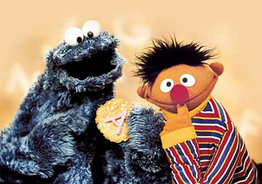 "Ernie and Cookie Monster pinder over the letter of the day ""A"". This is a new segment appearing in each Sesame Street episode. HANDOUT."