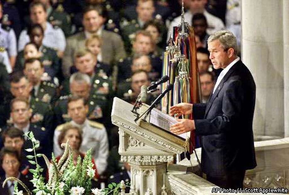 President Bush, right, speaks during a national day of prayer and remembrance service at the National Cathedral in Washington, Friday, Sept. 14, 2001. (AP Photo / J. Scott Applewhite)