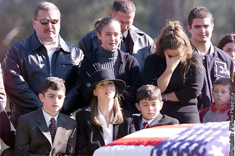 His wife Mary Elen and stepsons(sitting), along with otherfamily members, sit in front of the casket of Marine Capt. Matthew Bancroft a tanker pilot killed when he crashed into a mountain in Pakistan. At San Carlos Cememtary, Monterey  by Vince Maggiora Photo: VINCE MAGGIORA