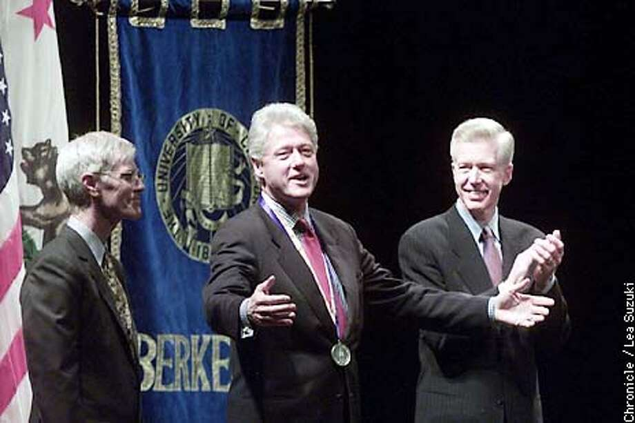 Clinton is awarded the Berkeley medal before his address as Orville Schell (left) and Gov. Gray Davis look on. Bill Clinton gives an address on the impact of globalization at UC Berkeley followed by a question and answer session by Orville Schell, dean of the Graduate School of Journalism. Photo by Lea Suzuki/SAN FRANCISCO CHRONICLE Photo: LEA SUZUKI