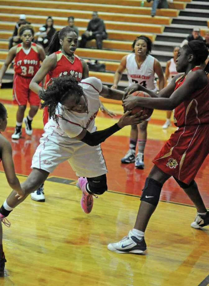 Langham Creek's Caylinne Martin, left, fights for a rebound. Photo: L. Scott Hainline / For The Chronicle