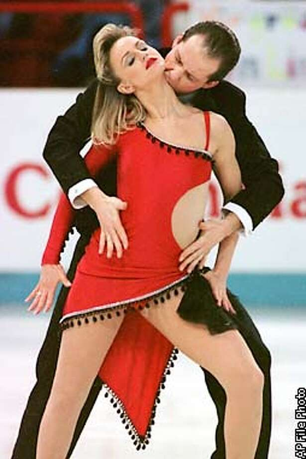 France's Pascal Lavanchy kisses his partner Sophie Moniotte during their original dance program at the European Figure Skating Championships in Paris Thursday Jan 23, 1997. (AP photo/Michel Lipchitz)