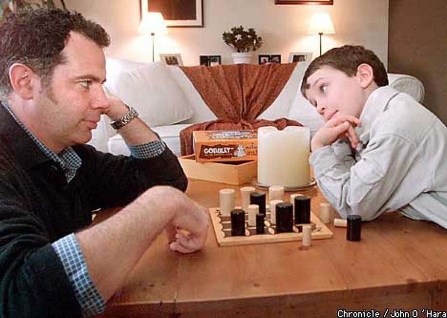 """Mill Valley, CA  """"Gobblet"""", best new games of 2001.  Thierry Donoual's left, and son Axel right  Photo/John O'Hara Photo: John O'Hara"""