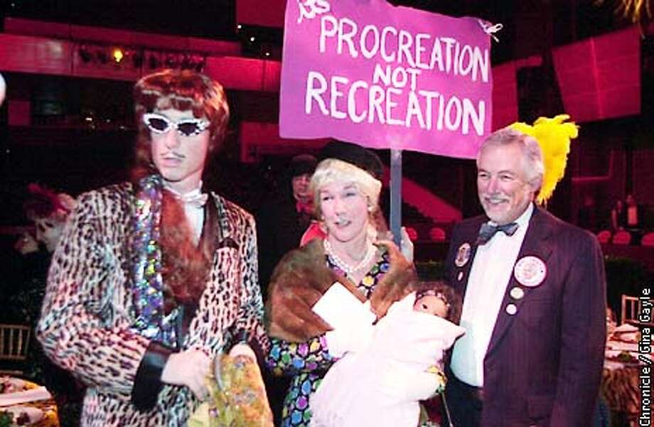 Susie Tompkins Buell is flanked by her husband Mark Buell on the right and another Artsist Ball party goer, Larry Connolly on the left at this year's festivities at Yerba Buena Gardens. Photo by Gina Gayle/The SF Chronicle. Photo: GINA GAYLE