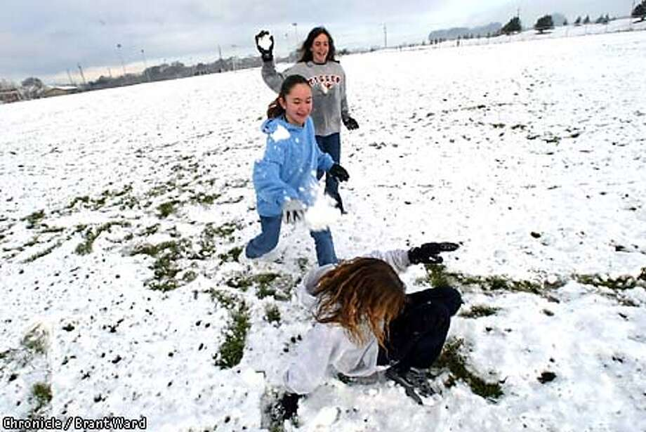 "At Petaluma's Prince Park, a group of Junior High School students who had a ""snow day"" off from school got a little rough in the snow. Ashley Marshall, on ground, got attacked by Tiffany Ryman, in blue shirt (middle) and Alyson McConnell. By Brant Ward/Chronicle Photo: BRANT WARD"