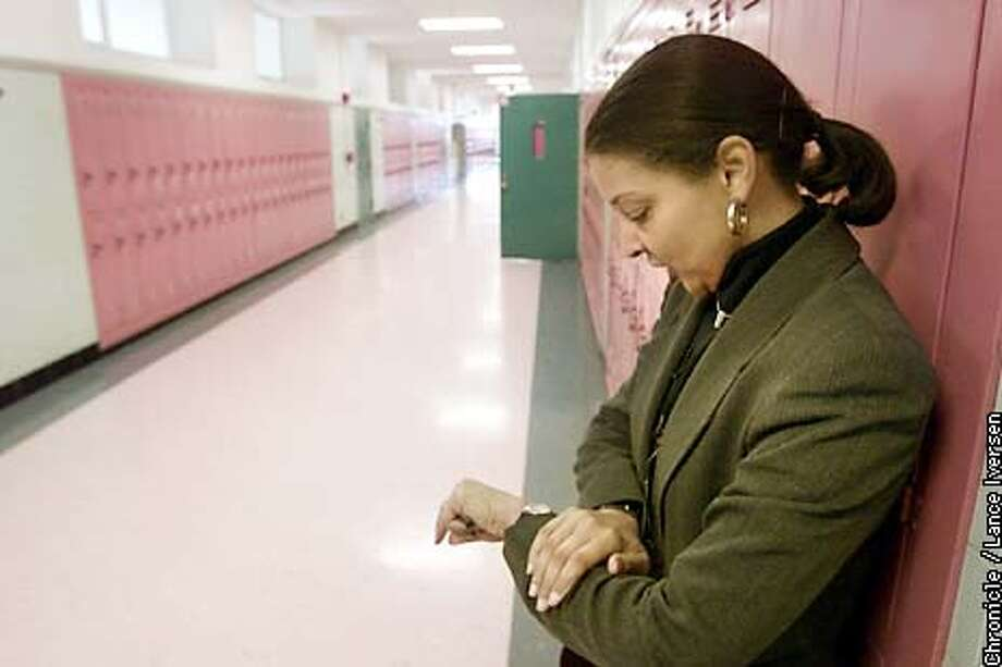 Castlemont High School principal Debbra Lindo (cq) checks the 9th grade house halls shortly after lunch break looking for stragglers. .BY LANCE IVERSEN/SAN FRANCISCO CHRONICLE Photo: LANCE IVERSEN