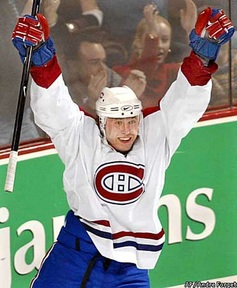 Montreal Canadiens' Sergei Berezin of Russia celebrates after scoring against the San Jose Sharks' during the third period of NHL action in Montreal Sunday Jan. 27, 2002. The goal was the clubs 10,000th at home, making the Canadiens the first team in NHL history to accomplish the feat. (AP Photo/Andre Forget) Photo: ANDRE FORGET