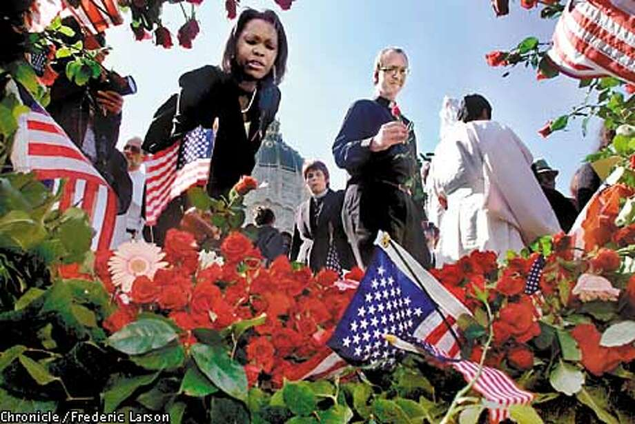 """: Hundreds who attended """"San Francisco Day of Remembrance,"""" at Bill Graham Civic Auditorium, SF laid roses in front of City Hall in remembrance of the tragedy. Chronicle photo by Frederic Larson Photo: FREDERIC LARSON"""