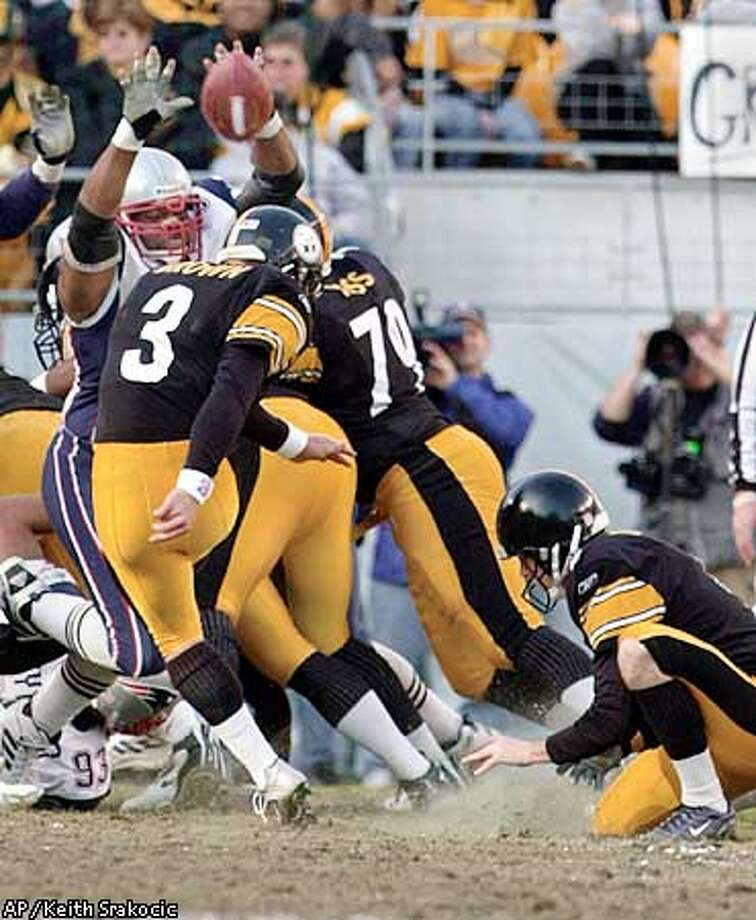 Pittsburgh Steelers kicker Kris Brown (3) has his field goal attempt blocked by New England Patriots' Brandon Mitchell in the third quarter of the game Sunday, Jan. 27, 2002, in Pittsburgh. The Patriots Troy Brown, not shown, recovered the ball and lateraled to Antwan Harris, not shown, who ran it in for a touchdown. (AP Photo/Keith Srakocic) Photo: KEITH SRAKOCIC