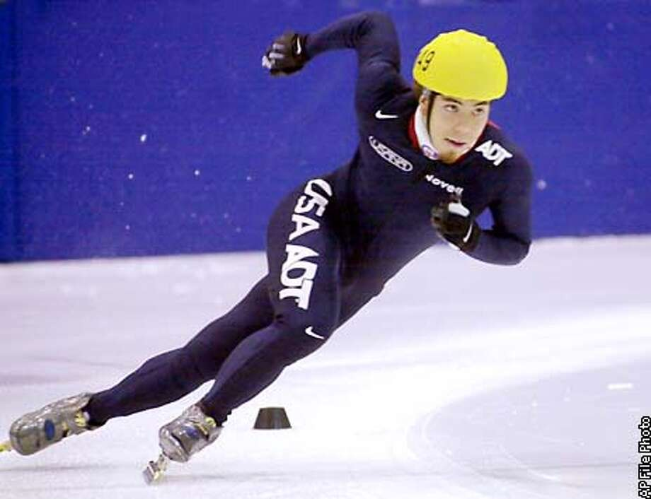 FOR USE ANYTIME WITH WINTER OLYMPICS STORIES--FILE--Apolo Ohno, of Seattle, skates during the Short Track time trials in this Dec. 14, 2001 photo in Kearns, Utah. With Americans enjoying the home-field advantage and some rising stars eager for a world stage, this could be a golden Winter Games for U.S. athletes. From the ice where Ohno races to the slopes where Bode Miller will be a favorite, America's athletes should give flag-waving fans plenty to cheer about.(AP Photo/Douglas C. Pizac) Photo: DOUGLAS C. PIZAC