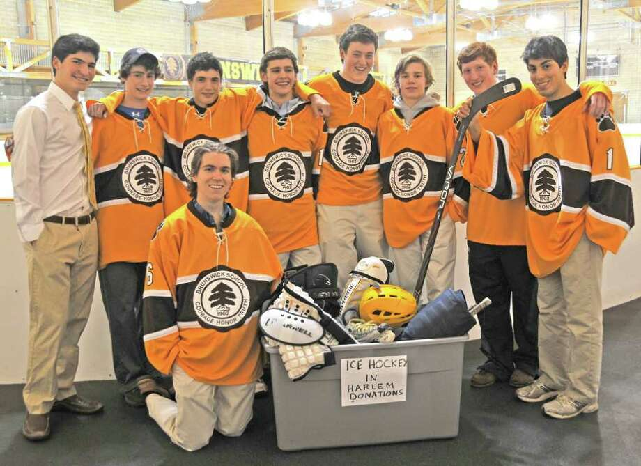 This year's edition of the Brunswick School hockey team wanted to share their passion for the sport with those who may not typically be exposed to the game, so they created the Brunswick School's Ice Hockey in Harlem Club. Members included, from left to right, Chris Brown, Harry Clifford, Sebbi Foster, Travis Buck, Kevin Duane, Nick Jermain, Stephan Seeger, Omeed Alidadi. In fthe front row is Andre Masse. Photo: Contributed Photo