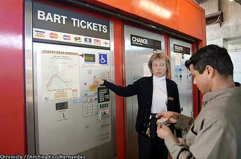 CHRISTINA KOCI HERNANDEZ/CHRONICLE  Concord BART station agent, Meg Shephard, helps a confused commuter, Sebastian Portillo, understand the new machines. New BART ticket machines at Concord BART station. Photo: CHRISTINA KOCI HERNANDEZ