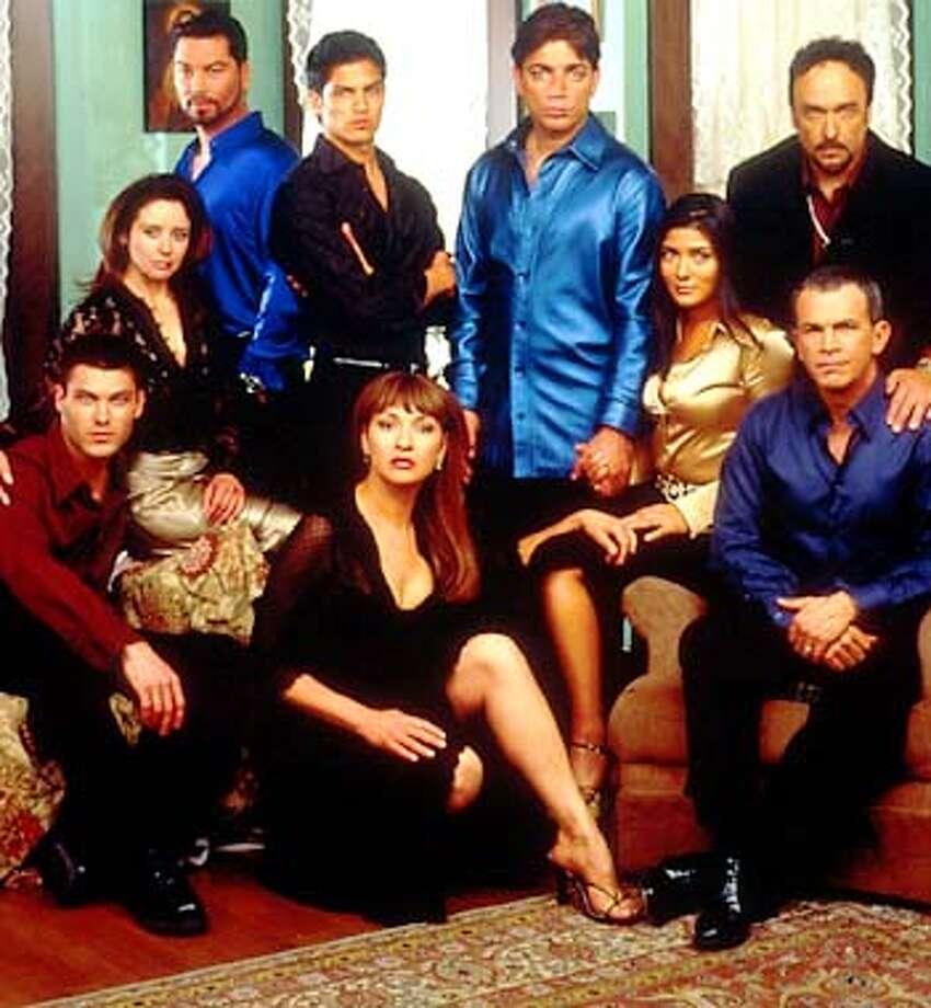 (L-R clockwise) BRIAN A. GREEN as Luke, RUTH LIVIER as Yolanda, MAURICIO MENDOZA as Miguel, NICHOLAS GONZALEZ as Alex, MICHAEL DeLORENZO as Carlos, MARISOL NICHOLS as Victoria,DANIEL ZACAPA as Ruben, TONY PLANA as Roberto, and ELIZABETH PEA as Bibi. Photo: Frank Ockenfel