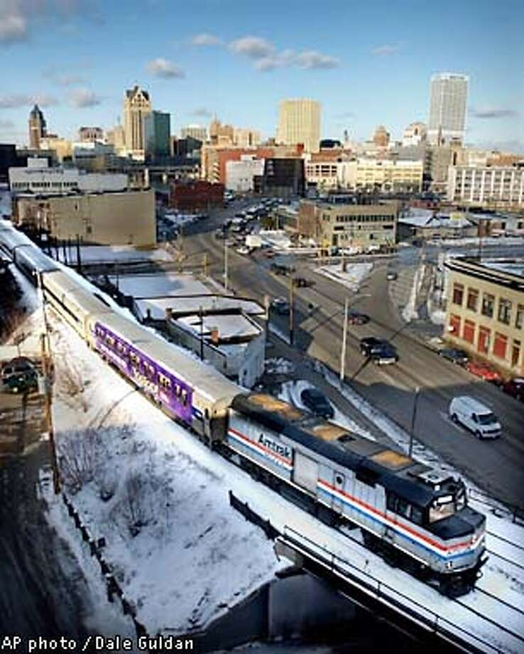 An Amtrak train, part of Hiawatha Service, leaves Milwaukee bound for Chicago on Friday, Feb. 1, 2002. Hiawatha Service between the cities would be one of the remaining passenger train services left in the country if Amtrak discontinues long-distance overnight passenger service in October, as it threatened to do Friday. (AP photo/The Milwaukee Journal Sentinel, Dale Guldan) Photo: DALE GULDAN