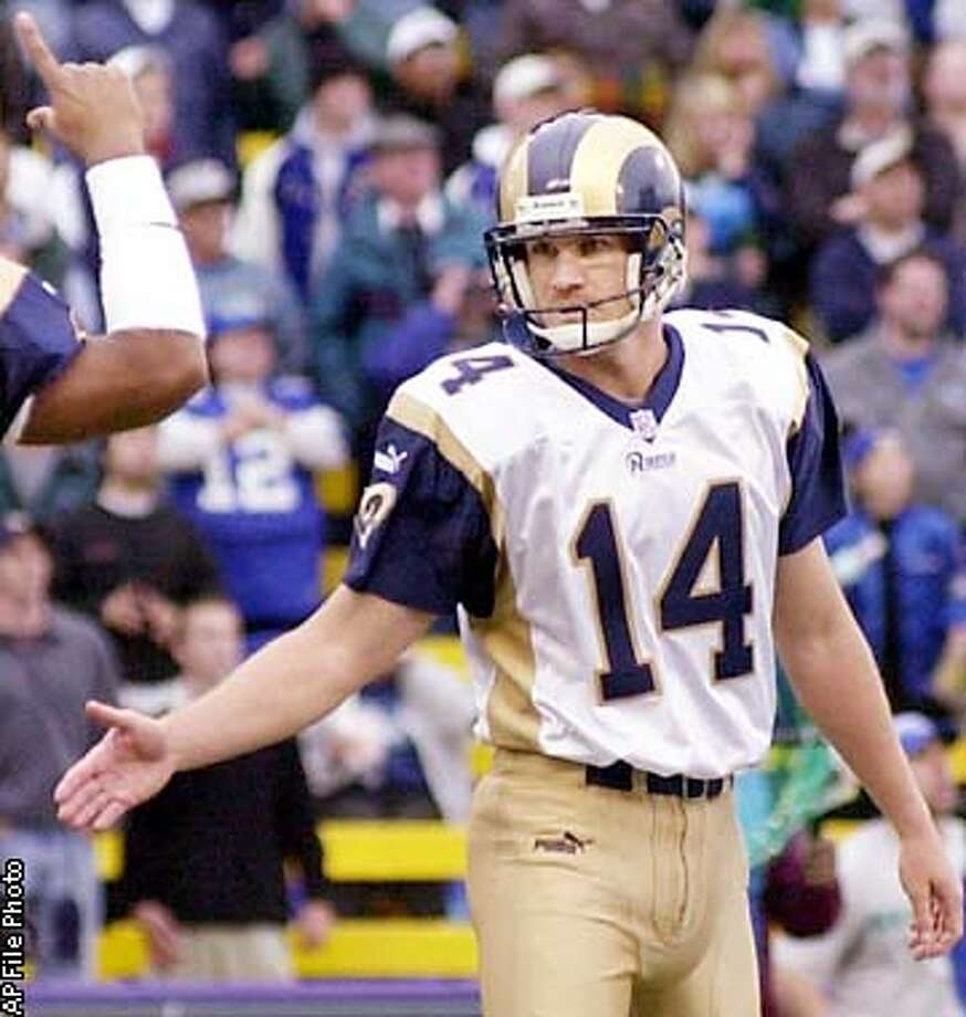St. Louis Rams kicker Jeff Wilkins (14) turns to holder Keith Lyle after Wilkins fourth quarter field goal was declared good, giving the Rams a last-minute lead over the Seattle Seahawks Sunday, Sept. 10, 2000 in Seattle. The Rams won, 37-34. (AP Photo/Elaine Thompson) Photo: ELAINE THOMPSON