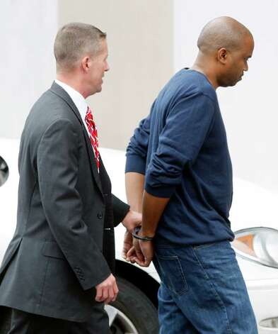 Gemase Simmons (right) was found guilty of child porn, extortion and bank fraud. Photo: William Luther, San Antonio Express-News / © 2012 SAN ANTONIO EXPRESS-NEWS