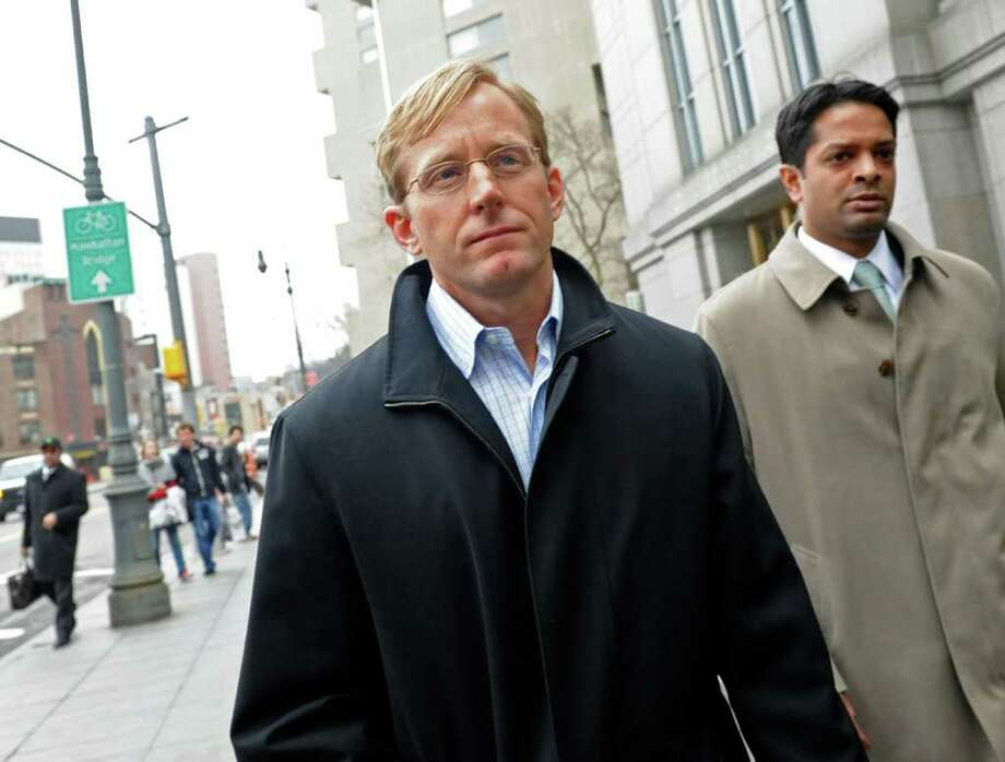 Chip Skowron, former portfolio manager with FrontPoint Partners LLC, center, exits federal court with his attorney Samidh Guha, in this file photo. Skowron pleaded guilty to insider trading charges.   (Photographer: Louis Lanzano/Bloomberg) Photo: Louis Lanzano, Bloomberg / © 2011 Bloomberg Finance LP