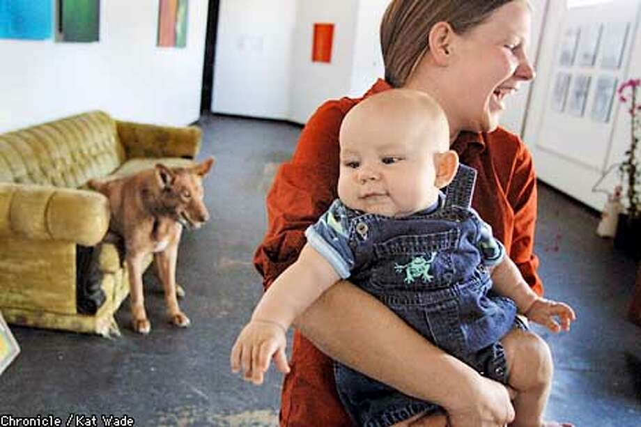Writer Laura Birchard and there son, Theo, 4 mos., chat with other residents (not pictured) in the Gallery portion of The Creamery a live/work space for 33 artists created by Cochrane and his wife Inge Halliday (Not pictured) in Oakland. Another resident, Barney, the dog sits on the couch awaiting the return of his owner. SAN FRANCISCO CHRONICLE PHOTO BY KAT WADE Photo: KAT WADE