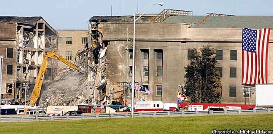 Heavy equipment moved onto the scene of the devestation at the Pentagon Building today. A pulverizer breaks up the larger pieces of debris so they can be hauled away. by Michael Macor/The Chronicle Photo: MICHAEL MACOR